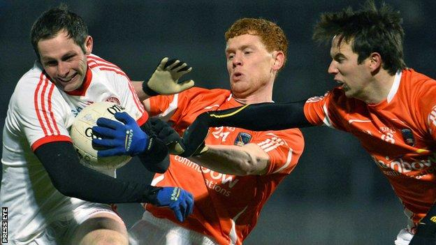 Tyrone's Ronan McNabb is challenged by Kyle Carragher and Tony Kernan of Armagh