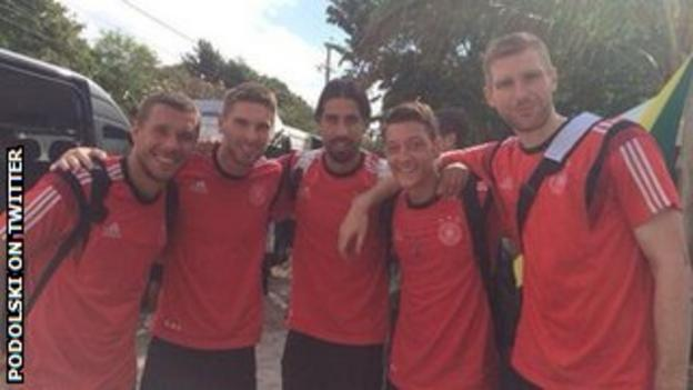Lukas Podolski (left) and some of his Germany team-mates on their way to Belo Horizonte to play Brazil