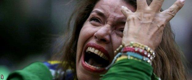 A Brazil soccer fan cries as Germany scores against her team at a semifinal World Cup match as she watches the game on a live telecast in Belo Horizonte, Brazil,