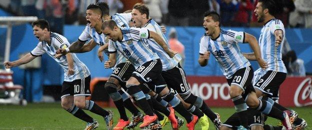Argentina celebrate winning the penalty shootout