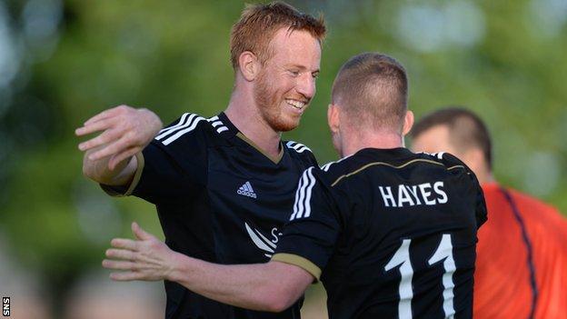 Adam Rooney scored a hat-trick as Aberdeen beat Daugava Riga 3-0