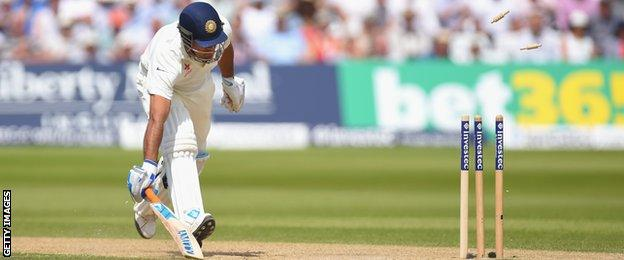 India captain Mahendra Dhoni is run out