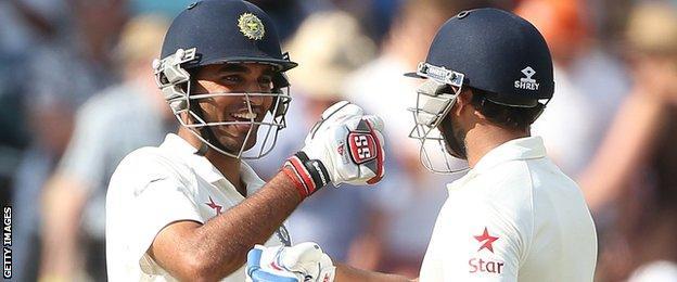 India's Mohammed Shami (L) and India's Bhuvneshwar Kumar celebrate