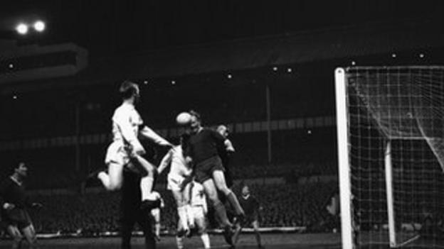Slovan Bratislava keeper Viliam Schrojf clears a corner during the quarter final of the European Cup-Winners' Cup at White Hart Lane, which Tottenham Hotspur won 6-0. Jumping with him are Frank Saul (left) and John White, March 1963.