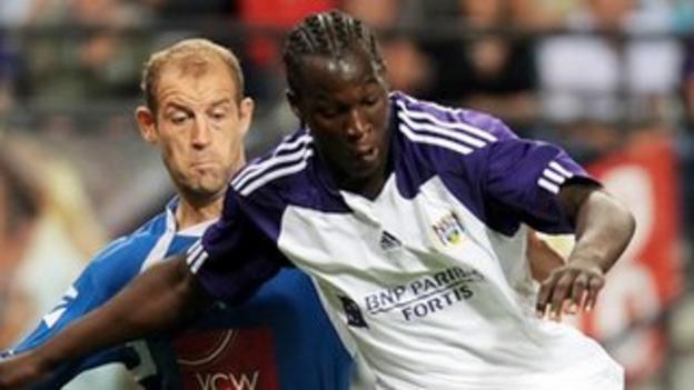 TNS defender Steve Evans tussles for the ball with Romelu Lukaku against Anderlecht, August 2010