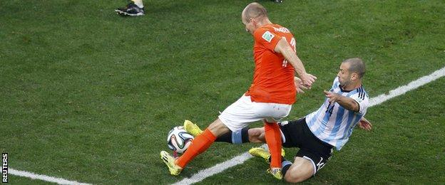 Argentina midfielder Javier Mascherano (right) tackles Netherlands forward Argen Robben