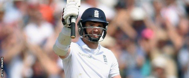 James Anderson raises his bat for the first time in competitive cricket