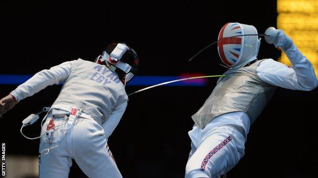 James Davis (right) in action against Egypt's Tarek Ayad at London 2012