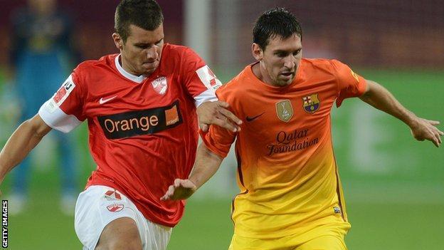 George Tucudean and Lionel Messi