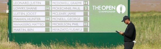 Tiger Woods pictured in front of a scoreboard during a practice round at Hoylake
