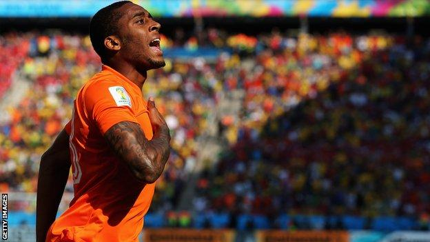 Leroy Fer celebrates scoring for the Netherlands against Chile at the World Cup