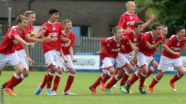 Shelbourne players race from the centre circle after winning the Under-14 plate final on penalties
