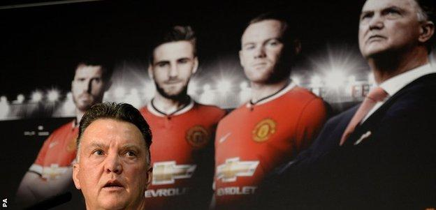 New Manchester United manager Louis van Gaal, speaks during a press conference at Old Trafford