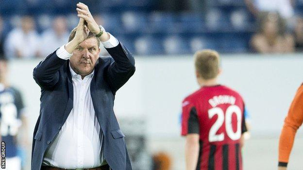 Tommy Wright applauds the 800 or so travelling St Johnstone supporters