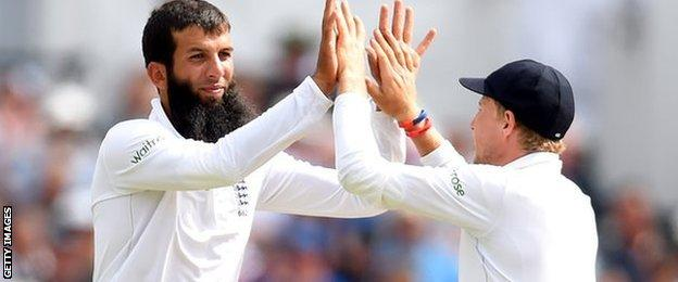 Moeen Ali and Joe Root celebrate taking Stuart Binny