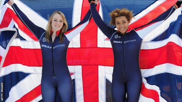 Jazmin Sawyers and Mica McNeil in front of a Union flag