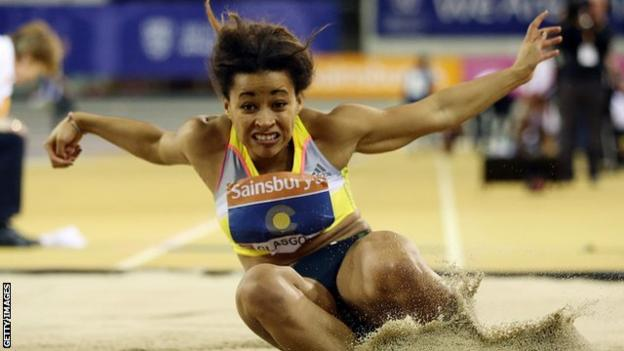 Jazmin Sawyers as she lands in the long jump pit