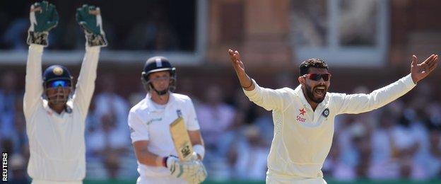 India's Ravindra Jadeja traps Joe Root lbw
