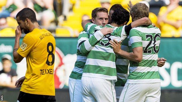 Celtic players celebrating following Kris Commons' goal against Dynamo Dresden