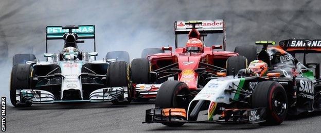 Lewis Hamilton collides with Kimi Raikkonen at the German Grand Prix.