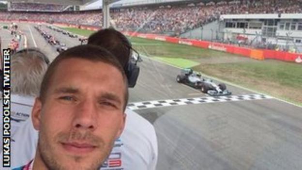 Lukas Podolski enjoys the German Grand Prix