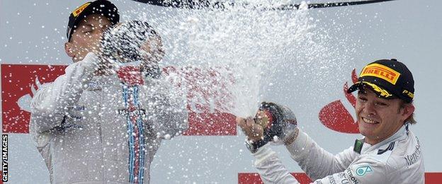 Valtteri Bottas and Nico Rosberg celebrate on the podium at Hockenheim.