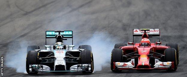 Lewis Hamilton locks up as he passes Kimi Raikkonen during the German Grand Prix