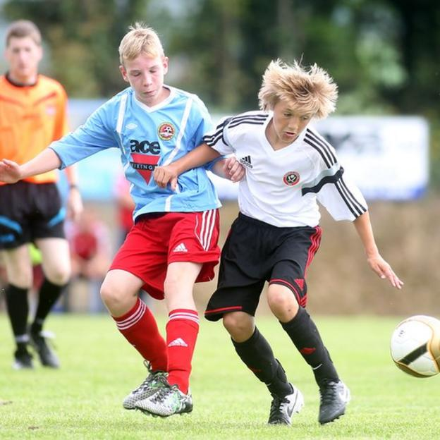 Robbie Rhodes of Sheffield United competes against Carniny's Isaiah Close during an Under-13 match at the Foyle Cup