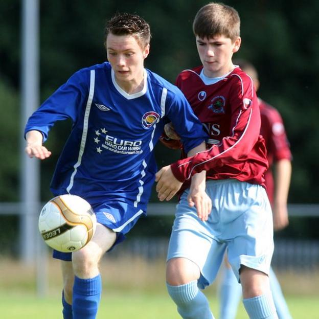 Loughside's Luke Watters and Brad Conor of Institute in Under-15 action at the Foyle Cup