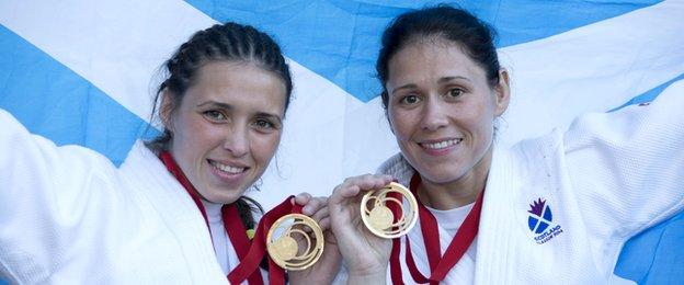 Kimberley and Louise Renicks pose with their Commonwealth Games judo gold medals