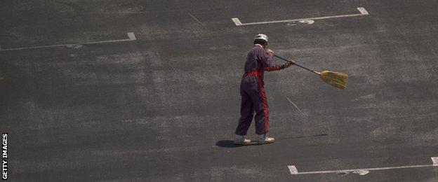 The track is swept clean of debris before the Mexican Grand Prix at the Mexico City circuit