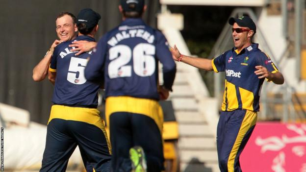 Glamorgan players congratulate Graham Wagg after he claimed the wicket of Michael Klinger in the T20 Blast match against Gloucestershire in Cardiff.