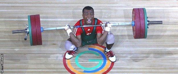 Charles Ssekyaaya of Uganda competes in the men's 62kg