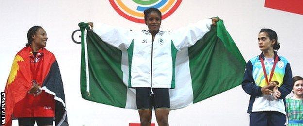 Silver medalist Dika Toua of Papa New Guinea, Gold medalist Chika Amalaha of Nigeria and Bronze medalist Santoshi Matsu of India