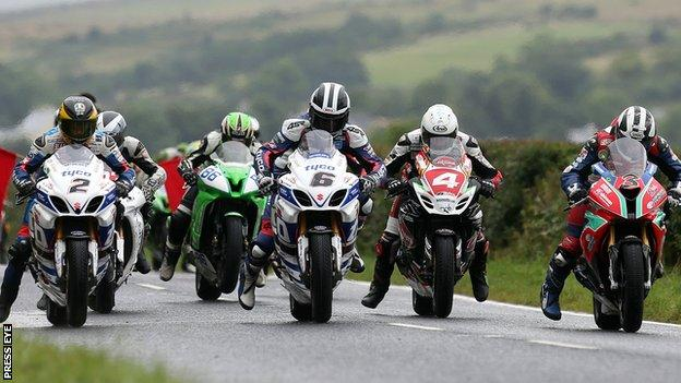 Guy Martin, William Dunlop and Michael on the start line for the Open race