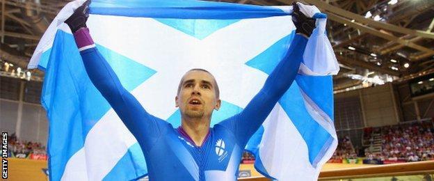 Neil Fachie of Scotland celebrates after winning gold in the men's sprint B tandem final