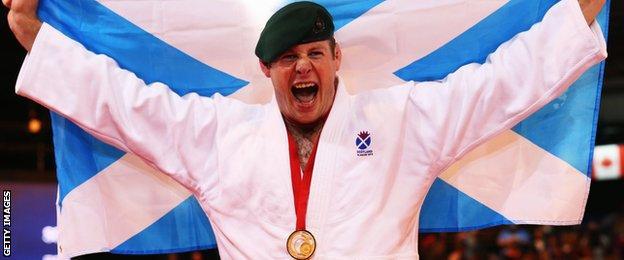 Chris Sherrington celebrates his gold medal in the +100kg
