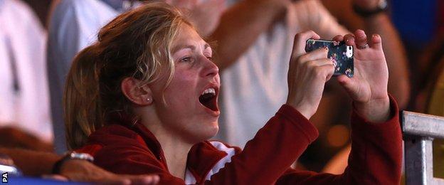 "Gemma Gibbons takes photos of her husband, Scotland""s Euan Burton receiving his gold medal"