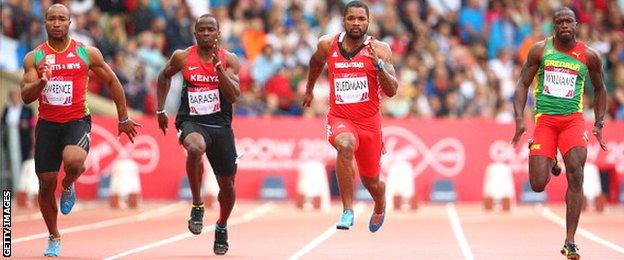 Brijesh Lawrence of St Kitts and Nevis, Stephen Barasa of Kenya, Keston Bledman of Trinidad and Tobago and Paul Williams of Grenada competes in the Men's 100m