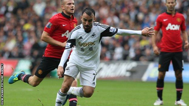 Leon Britton in action against Manchester United