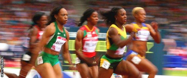 Veronica Campbell-Brown of Jamaica (second from left) wins her heat in the women's 100 metres
