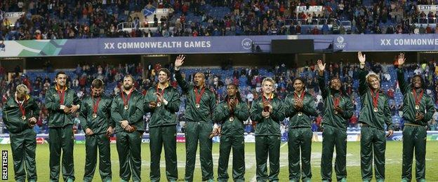 South Africa's triumphant players wave to the crowd after winning gold