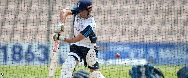 Alastair Cook warms up in the nets