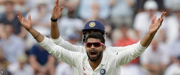 India celebrate the dismissal of Alastair Cook