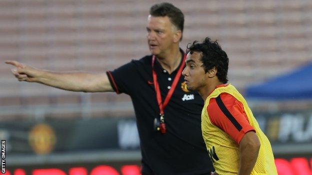 Manchester United manager Louis Van Gaal (left) and defender Rafael