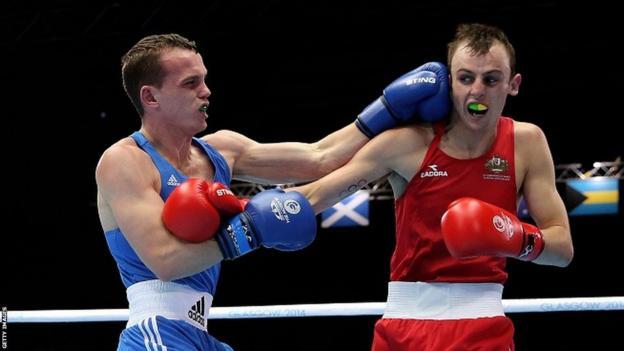 Sean McGoldrick began the defence of his bantamweight title defeating Australia's Jackson Woods on a split decision.