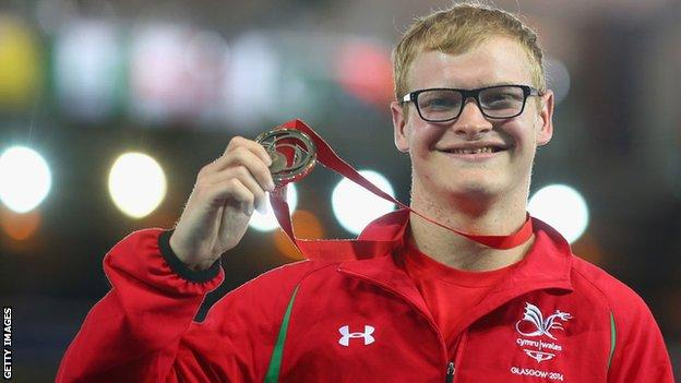Rhys Jones shows off the bronze medal he won in the T37 100m final at the Commonwealth Games