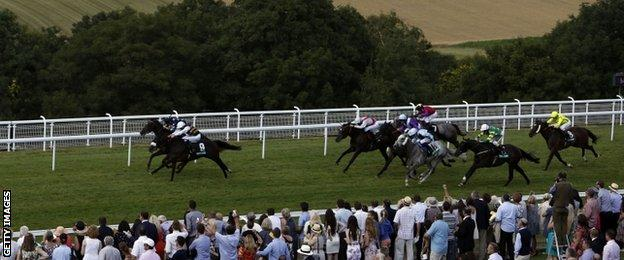 Van Percy (number nine) winning the Summer Stakes at Glorious Goodwood
