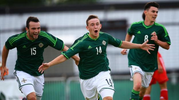 Mikhail Kennedy celebrates after scoring NI's second goal in their 2-0 Elite section win over China