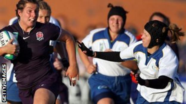 Kazakhstan's Irina Adler (right) tries to make a tackle against England in the 2010 World Cup